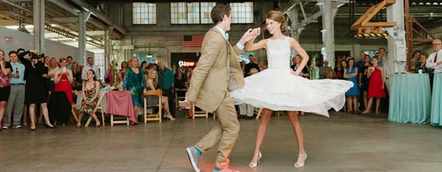 A bride and groom dancing at Uppercut Gym during their wedding