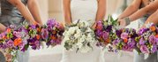 A bride and her bridesmaids show off their bouquets