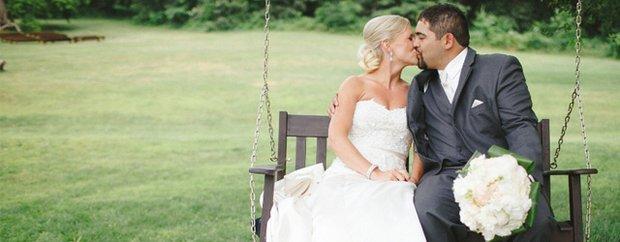 Whitney Furst Photography rustic wedding couple kissing on park swing
