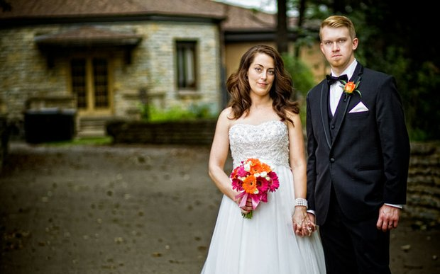 A bride and groom in front of their venue | photo by Custom Creations Photography