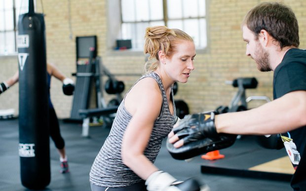 A trainer and his client working out at Bodies by Burgoon