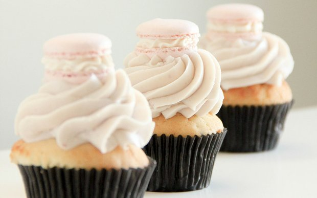 Cupcakes topped with mini macarons from Farina Bakeshop