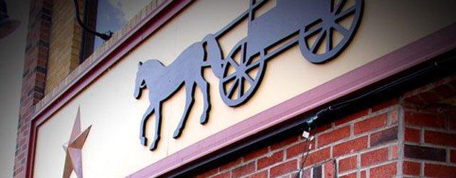 Exterior logo at The Corner in Anoka