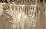 A rack of dresses at Bridal Accents Couture