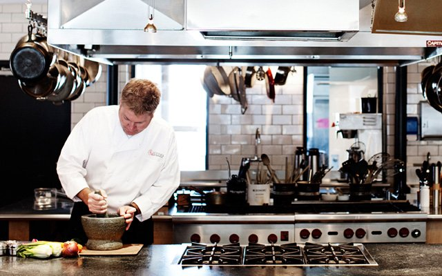 A chef cooking at Cooks of Crocus Hill