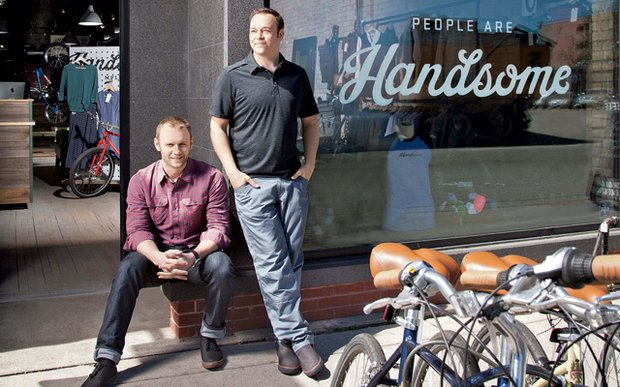 Ben Morrison and Jesse Erickson, owners of Handsome Cycles, stand in front of their shop