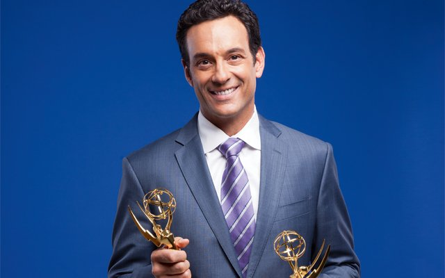 WCCO anchor and Mpls.St.Paul Magazine December cover guy, Frank Vascellaro, holding his emmys