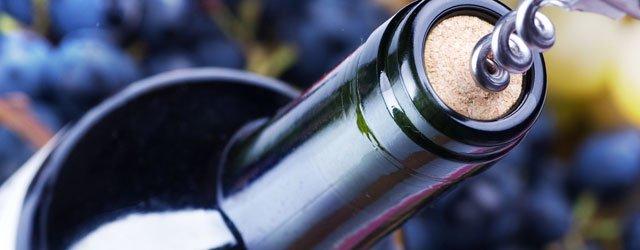 Wine bottle being uncorked