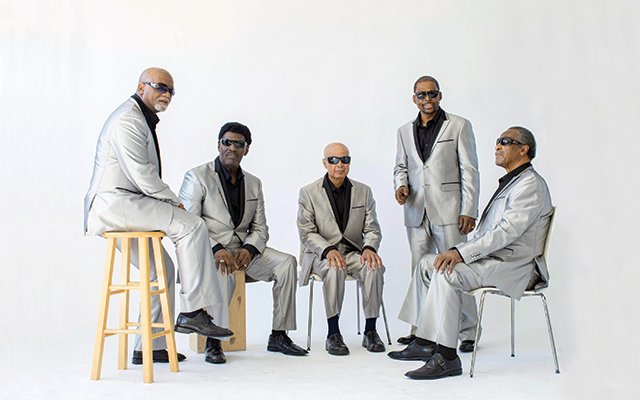"""Musical band with five members called """"Blind Boys of Alabama"""",  they are wearing silver suits"""