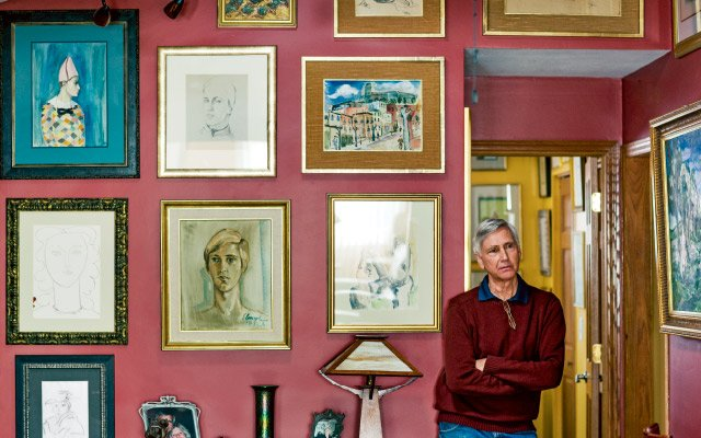 Mark Forgy at home with his collection of Elmyr de Hory forgeries.