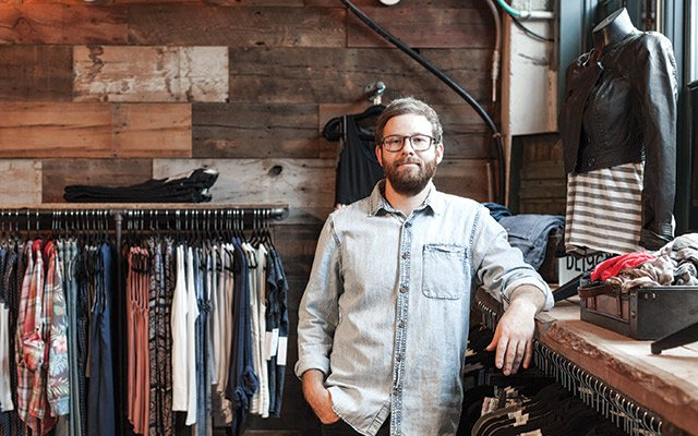 Atmosfere co-owner Damon Capetz in his North Loop storefront