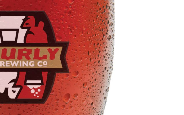 Close up of beer glass from Surly Brewing Co.
