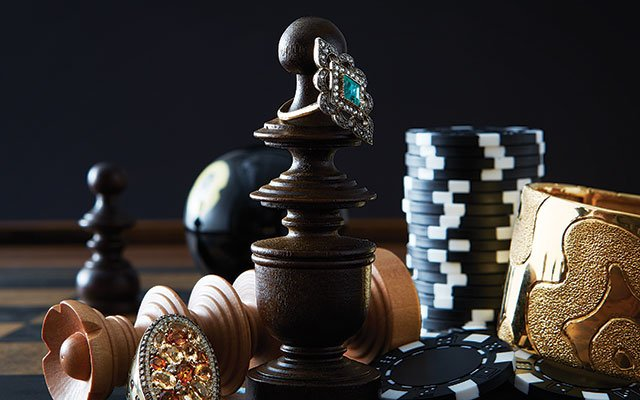 Chess pieces adorned with jewelry