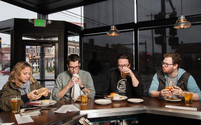 Editors eating burgers for the 2015 Burger Crawl