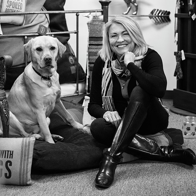 Rebecca Kolls with her dog, Cash, who hangs out at the store