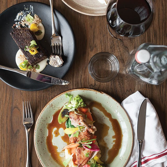 Pastrami-cured ocean trout, black pudding, and roast chicken at Heirloom in St. Paul