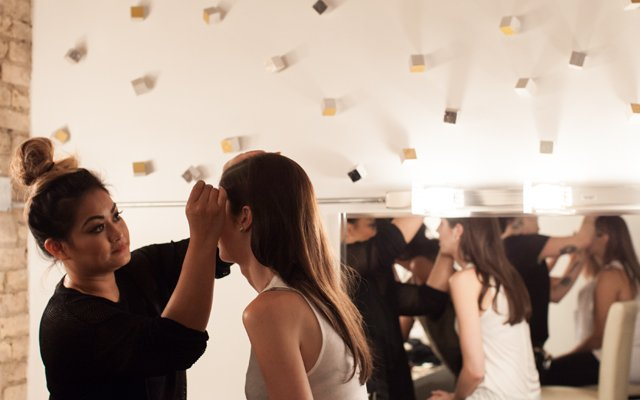 Woman getting her makeup done by a makeup artist