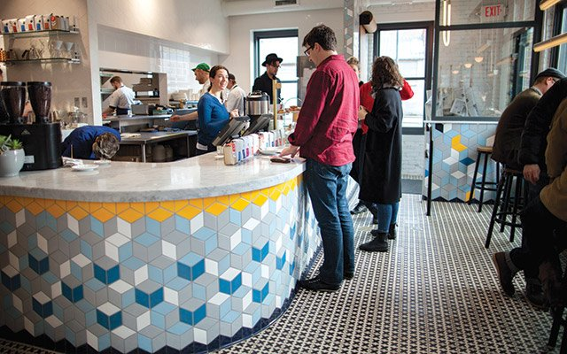 Geometric tiles on a counter from Mercury Mosaics at The Bachelor Farmer Cafe