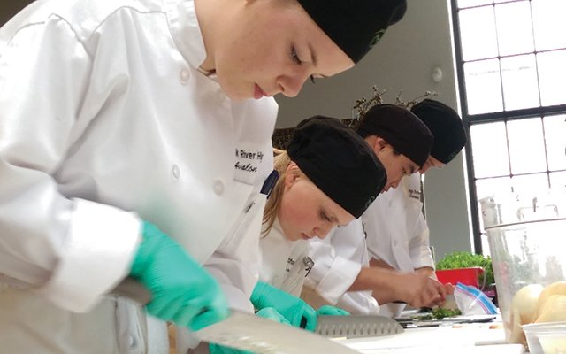 The Elk River ProStart team practicing for a cooking competition