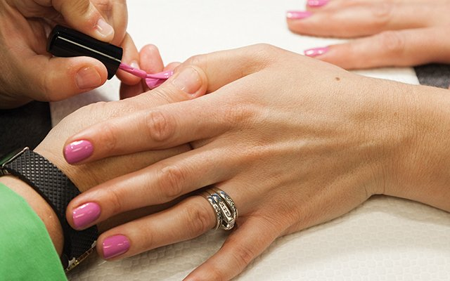 A woman getting a manicure at Dazzle Dry