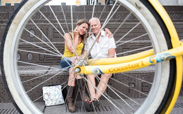 Janna and Paul Krawczyk behind a bike wheel