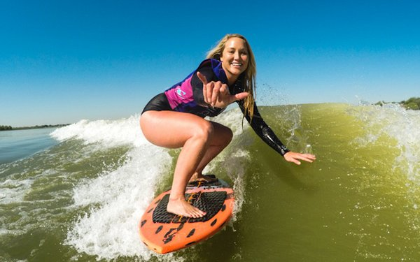 Woman surfing with iDol Surf
