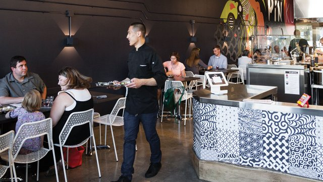 People dining in Japanese street food restaurant
