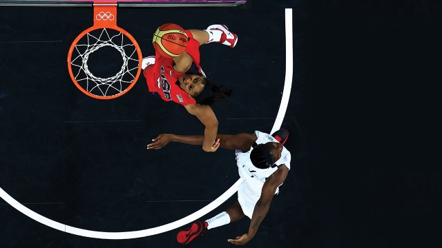 The U.S. Women's National Team's Maya Moore dunks against Angola during a preliminary round of the 2012 Summer Olympics in London.