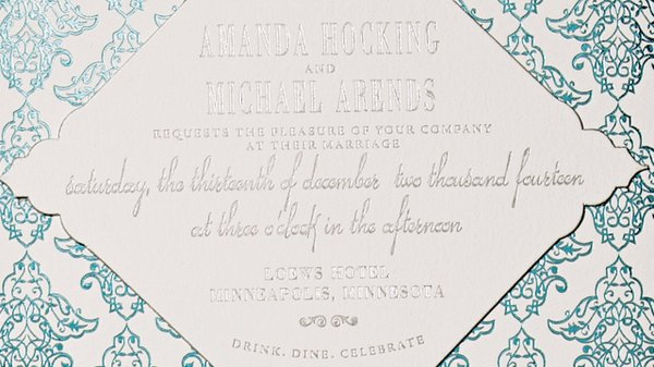 Turquoise and silver foil invite