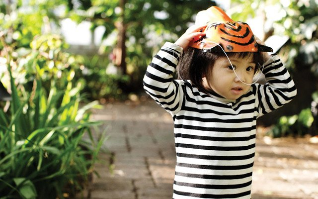 A child runs to her parents at the Como Zoo