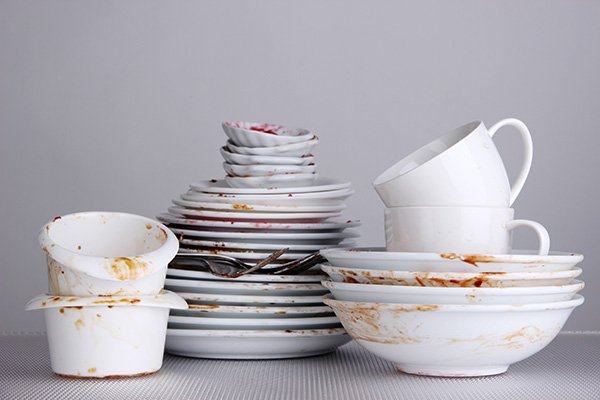 Stacked dirty dishes