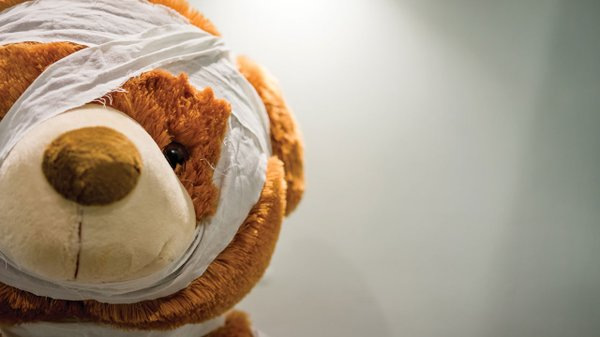 Teddy Bear with bandage wrapped around his head
