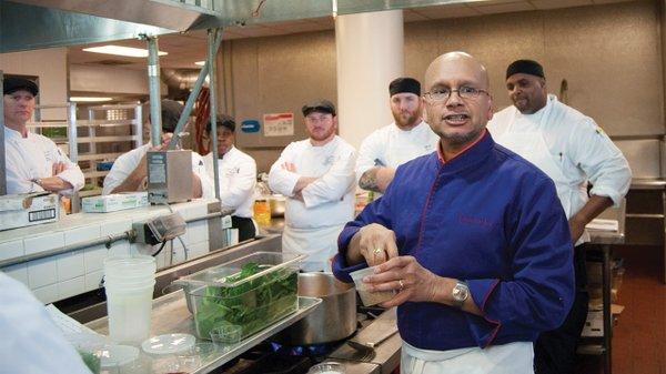 Raghavan Iyer talking with cooks at Emory University in Atlanta