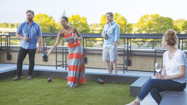Residents of The Flats apartments playing bocce ball