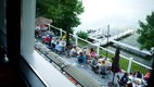 A view of the lake and outdoor seating at Birch's on the Lake