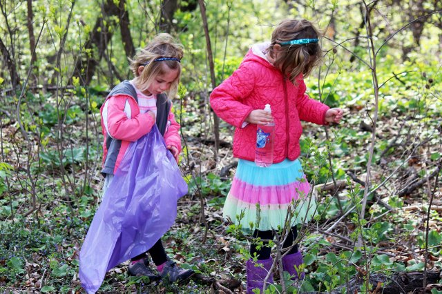 Two children pick up trash at Highland Park during last year's St. Paul Citywide Cleanup
