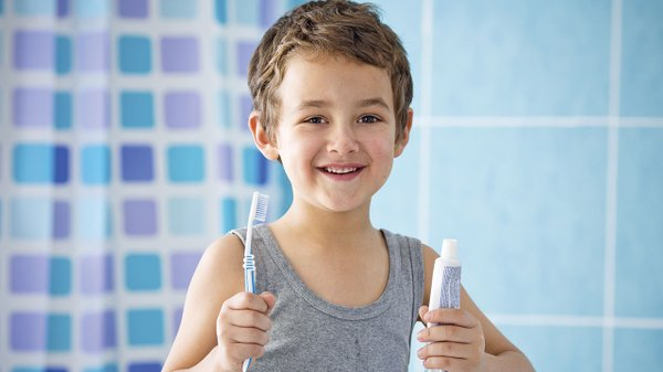 Kid with tooth brush