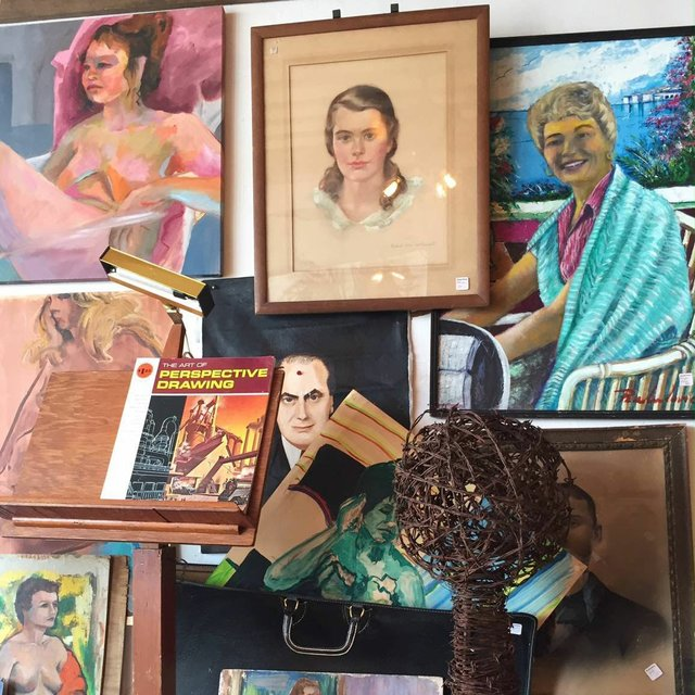 Vintage painted portraits at Mustard Moon and The Rider
