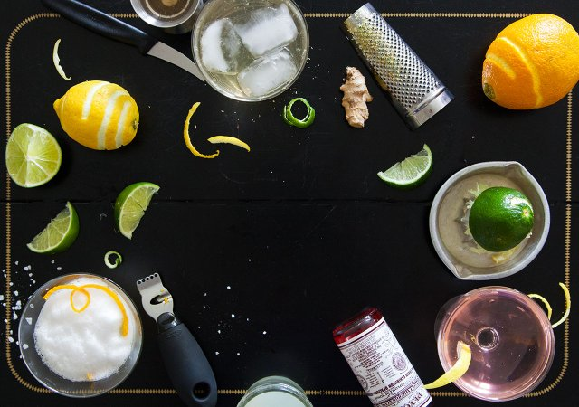 collage of lemons, limes, bitters and zester