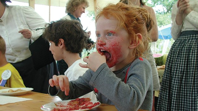 Kid-eating-pie-at-Historic-Forestville.jpg
