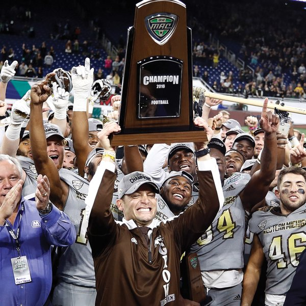 P.J. Fleck holding the MAC championship trophy in 2016
