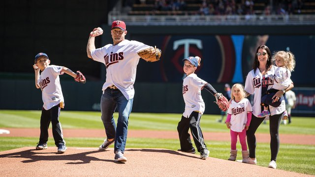 P.J. Fleck and his family throwing the first pitch at a Twins game