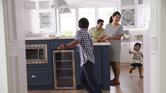 A family in a modern kitchen