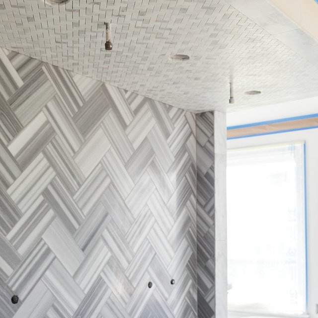 Gray and white herringbone bathroom tile