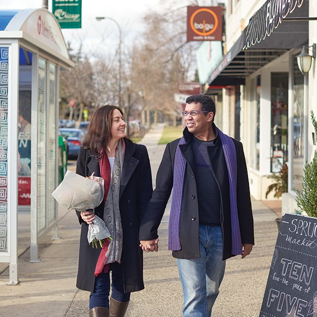 Derek Wallace and Philomena Kemsley walking in their neighborhood