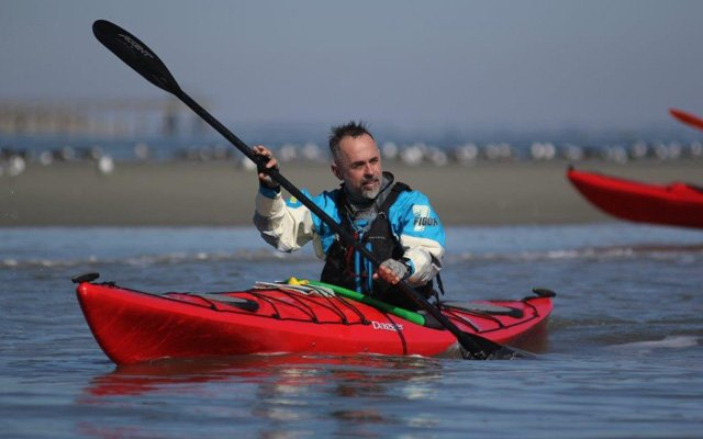 A man paddling with an Accent Paddle