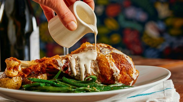 fried turkey leg with gravy and green beans