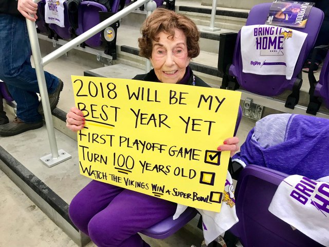 Millie Wall holding a sign at a Vikings game