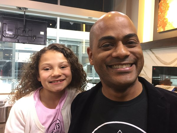 Funky Grits' restaurant owner Jared Brewington with his daughter Josephine