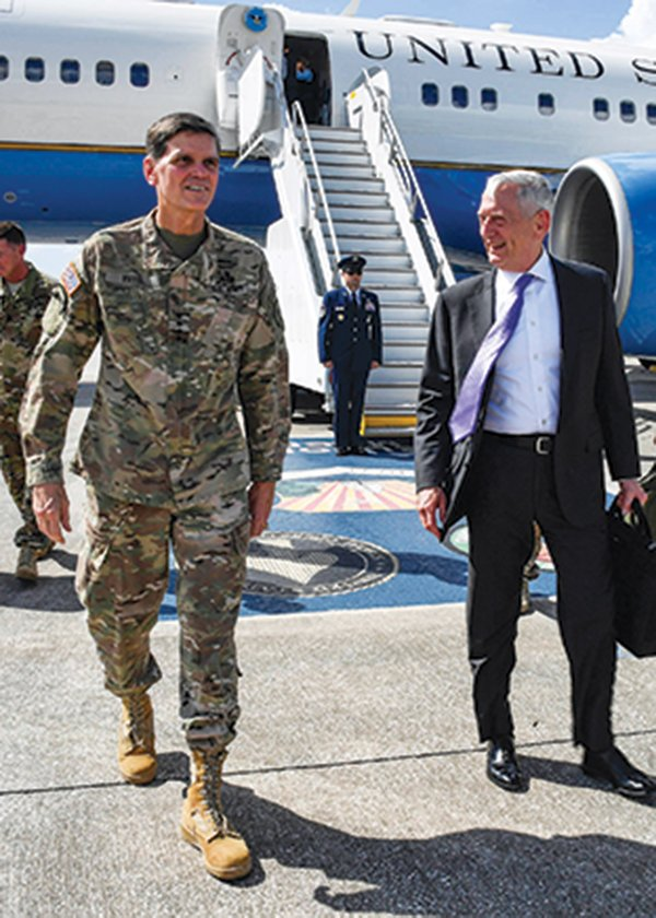 The general outside a C-40B with Secretary of Defense James Mattis.